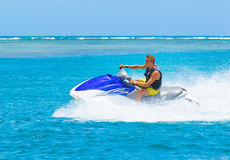 Young Man on Jet Ski. Tropical Ocean, Vacation Concept Royalty Free Stock Images