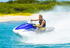 Young Man on Jet Ski. Tropical Ocean, Vacation Concept Royalty Free Stock Photography