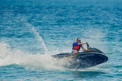 Young Man on Jet Ski. Tropical Ocean, Vacation Concept Stock Image