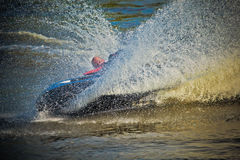 Young man on jet-ski turning around Royalty Free Stock Photography