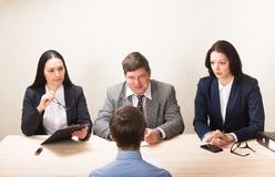 Young man during job interview and members of managemen. Young men during job interview and members of managemen. HR concept Stock Image