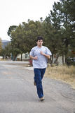 Young man jogging Royalty Free Stock Image