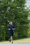 Young man jogging alone Royalty Free Stock Images