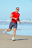 Young man jogging on the beach Stock Photography