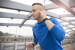 Young man jogging on a bridge Royalty Free Stock Image