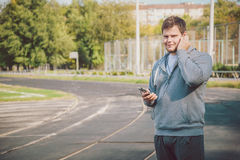 Young man jogging while listening to music Stock Photo