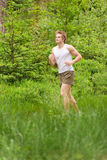 Young man jogging in nature Stock Photos