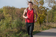 Young man jogging outdoor Royalty Free Stock Images