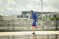 Young man jogging outdoors. Alone Stock Photos