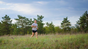 Young man jogging outdoors. Stock Photo