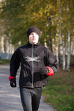 Young man jogging in park Stock Image