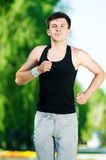 Young man jogging in park Royalty Free Stock Images