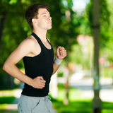 Young man jogging in park Royalty Free Stock Photo
