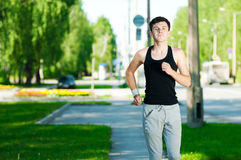 Young man jogging in park Royalty Free Stock Photography