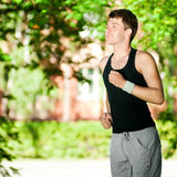 Young man jogging in park Stock Photography