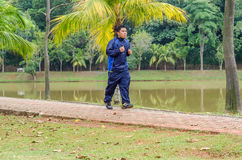 Young man jogging. In park Royalty Free Stock Image