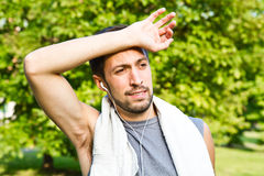 Young man jogging in park. Health and fitness Stock Photography