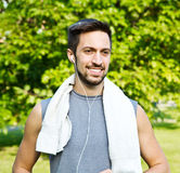 Young man jogging in park. Health and fitness. Stock Image