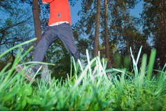 Young man jogging in the park Stock Photos