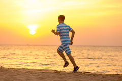 Young man jogging at the sea coast Royalty Free Stock Photo