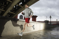 Young Man Jogging On Stormy Day Stock Photos