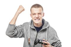 Young man with a joystick Royalty Free Stock Image
