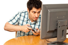 Young man with a joystick playing isolated Stock Photo