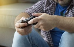 A young man with joystick playing video games at home spending t Royalty Free Stock Photo
