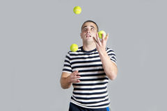 Young man juggling Stock Image