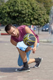 Young man juggling the ball. Royalty Free Stock Photos