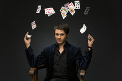 Young man juggling cards Stock Images