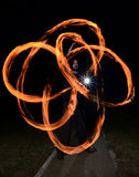 Young man juggling fire poi. Fire poi juggled by a young man, paint with fire stock photo