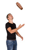 Young man juggling Royalty Free Stock Image