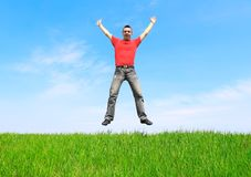 Young man jump on the meadow Royalty Free Stock Photos