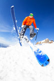 Young man in a jump while skiing view from below Stock Images