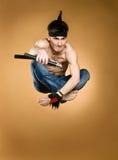 Young man jumping. Young attractive man jumping, studio shot Stock Image