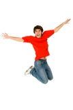 Young man jumping. Studio shot of a young man jumping Royalty Free Stock Photo