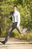 Young man jumping. Young business man jumping outside Royalty Free Stock Photo