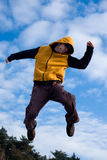 Young man jumping. In the air on a cold day Stock Photos