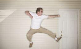 Young man jumping. Through the air in a combat punch Royalty Free Stock Images