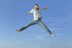 Young man jumping in the air Royalty Free Stock Photo