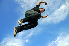 Young man jumping in air Stock Image