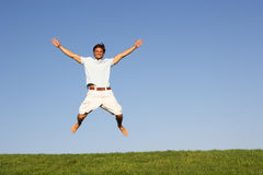 Young man jumping in air Royalty Free Stock Photos