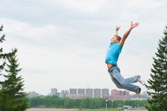 Young man jumping in air Stock Photography