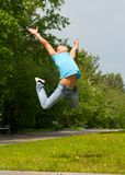 Young man jumping in air Royalty Free Stock Photo