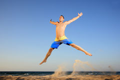 Young man jumping in the air Royalty Free Stock Photography