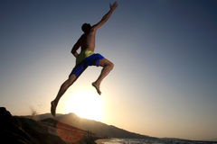 Young man jumping in the air Stock Images