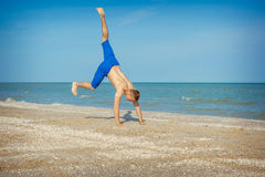 Young man jumping on beach. Young man jumping, fun sports on beach stock photos