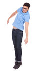 Young man jumping with feet together Stock Photography
