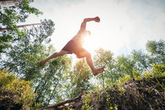 Young man jumping in the forest. Stock Images